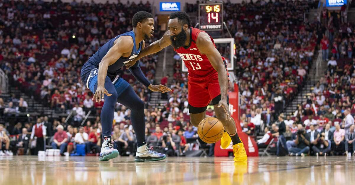 Houston Rockets guard James Harden (13) drives during the first half of an NBA game, Tuesday, March 10, 2020, at Toyota Center in Houston.