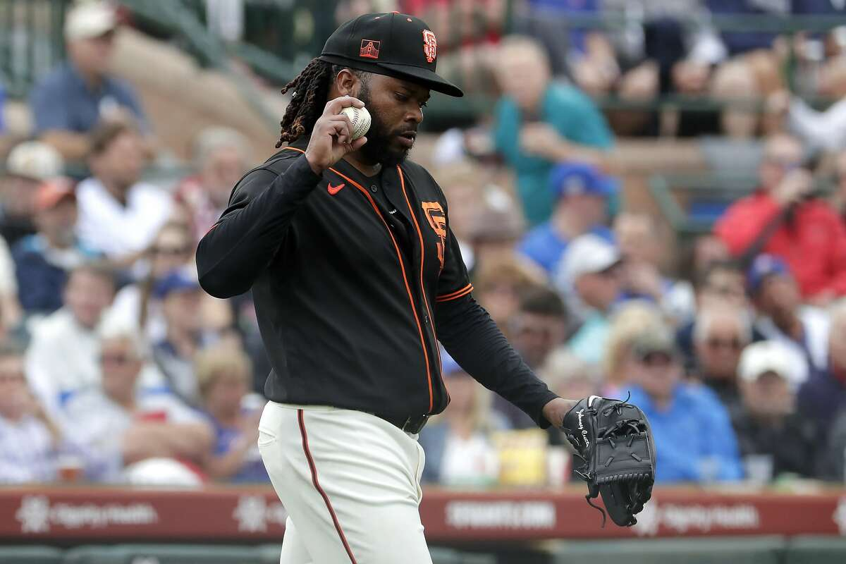 San Francisco Giants pitcher Johnny Cueto reacts after giving up a run against the Chicago Cubs during the second inning of a spring training baseball game Tuesday, March 10, 2020, in Scottsdale, Ariz. (AP Photo/Matt York)
