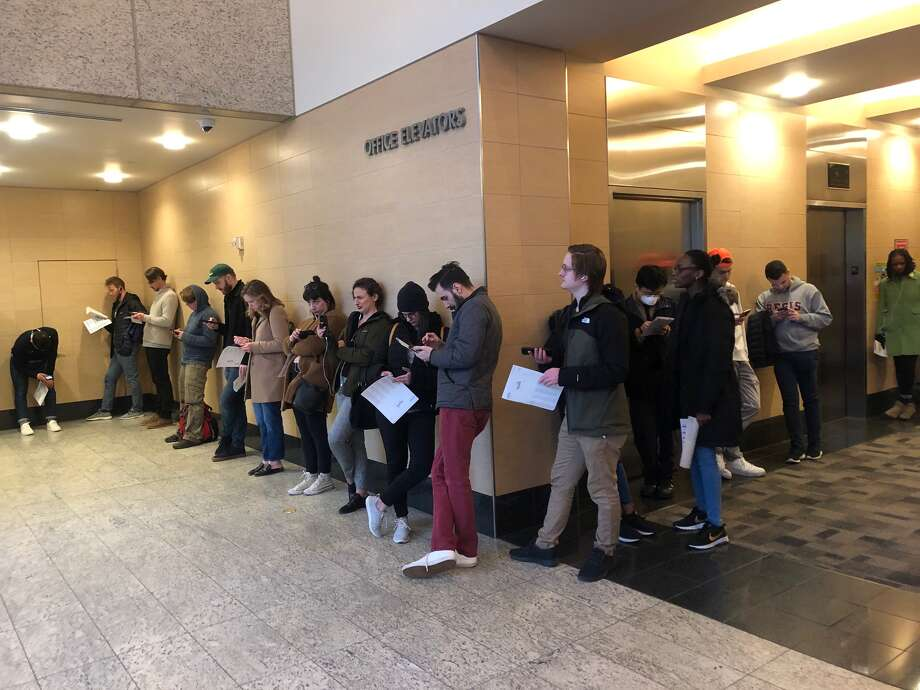 People wait in long lines at a downtown Seattle vote center to register and cast their ballots in the state's presidential primary. Photo: By Becca Savransky