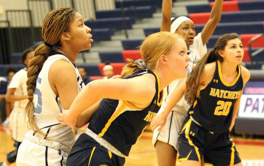 The Bad Axe girls basketball season came to an end on Tuesday night as the Hatchets fell to Flint Hamady, 46-18, at USA in regional play. Photo: Mark Birdsall/Huron Daily Tribune