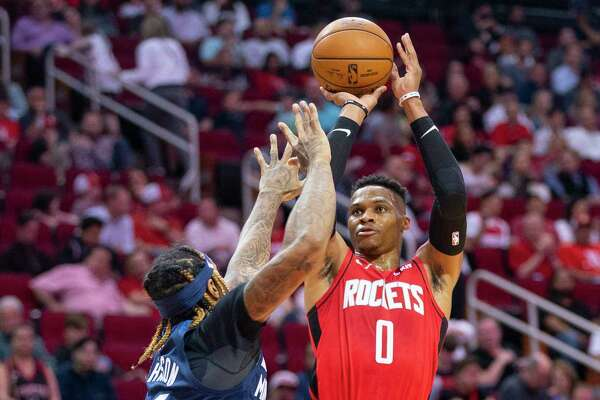 Houston Rockets guard Russell Westbrook (0) shoots over Minnesota Timberwolves forward James Johnson (16) during the first half of an NBA game, Tuesday, March 10, 2020, at Toyota Center in Houston.
