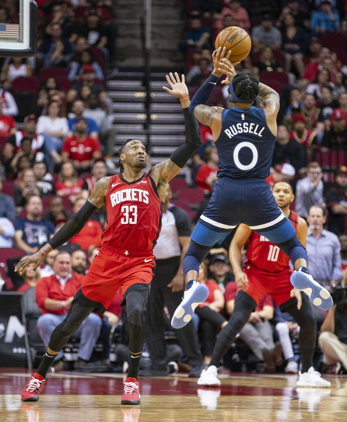 Minnesota Timberwolves guard D'Angelo Russell (0) shoots over Houston Rockets forward Robert Covington (33) during the second half of an NBA game, Tuesday, March 10, 2020, at Toyota Center in Houston.