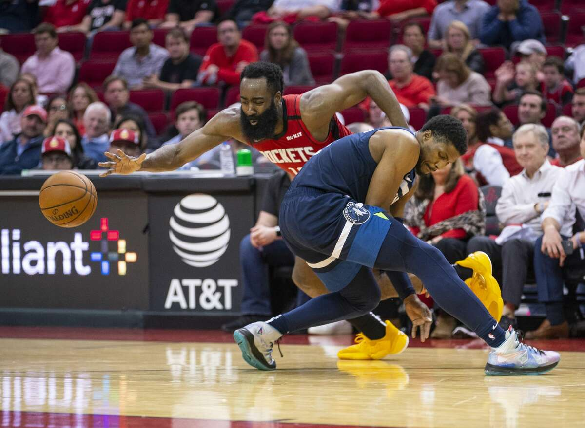 Houston Rockets guard James Harden (13) drives past Minnesota Timberwolves guard Malik Beasley (5) during the second half of an NBA game, Tuesday, March 10, 2020, at Toyota Center in Houston.