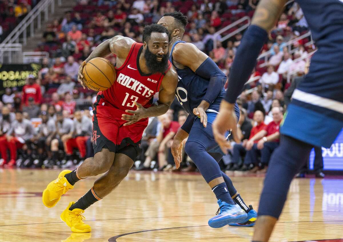 Houston Rockets guard James Harden (13) drives past Minnesota Timberwolves guard Josh Okogie (20) during the second half of an NBA game, Tuesday, March 10, 2020, at Toyota Center in Houston.