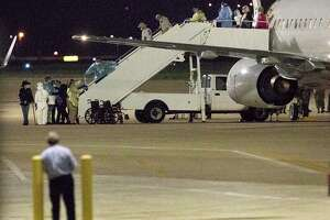 A charter flight from Oakland International Airport carrying passengers evacuated from the Grand Princess cruise ship arrives at Joint Base San Antonio-Lackland on Tuesday, March 10, 2020. The passengers will be housed on base during a federally mandated 14-day quarantine because they might have been exposed to the coronavirus.