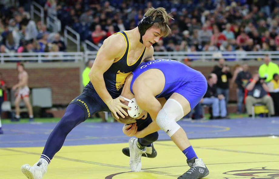 Bad Axe wrestler Sam Hass defends a single-leg takedown while competing during the state finals at Ford Field in Detroit. Photo: Bad Axe Grapplers/Submitted Photo