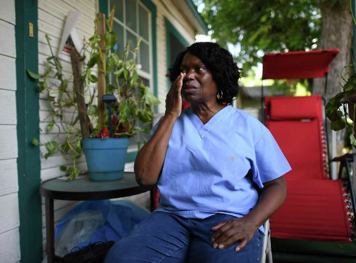 Marilyn Washington, who lives in East San Antonio, wipes away a tear during an interview in August 2019 as she speaks about the pressures of mounting unpaid bills when she was unable to work due to sickness. She works as a home healthcare provider and doesn't get paid sick leave. Washington said Tuesday that if she were to contract coronavirus she would opt to stay at home and forgo pay again rather than put elderly clients at risk.