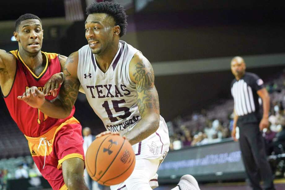 Texas Southern Tigers forward Justin Hopkins (15) drives past Grambling State Tigers guard Kelton Edwards (11) in the first half in the first half of the SWAC Tournament at the Health and Physical Education Arena on Tuesday, March 10, 2020. Photo: Elizabeth Conley, Houston Chronicle / Staff Photographer / © 2018 Houston Chronicle