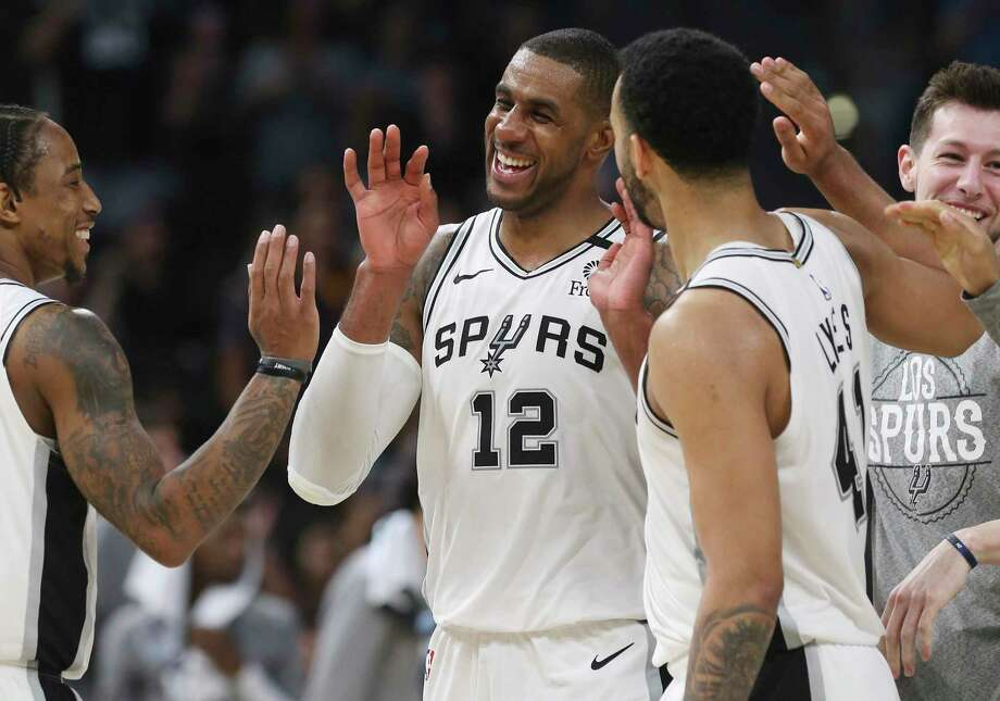 Spurs' LaMarcus Aldridge reacts after a score with teammate DeMar DeRozan (left) and Trey Lyles (41) during the game against the Dallas Mavericks on March 10. On Thursday, the NBA Board of Governors approved a plan to restart the interrupted 2019-20 season next month at the Walt Disney World Resort. Photo: Kin Man Hui, San Antonio Express-News / Staff Photographer / **MANDATORY CREDIT FOR PHOTOGRAPHER AND SAN ANTONIO EXPRESS-NEWS/NO SALES/MAGS OUT/ TV OUT