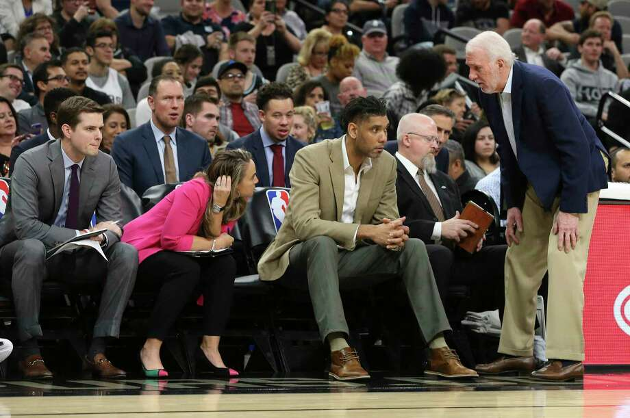 Spurs head coach Gregg Popovich (right) talks to his assistant coaches Tim Duncan (center), Becky Hammon and Will Hardy (left) during the game against the Dallas Mavericks at the AT&T Center on Tuesday, Mar. 10, 2020. Photo: Kin Man Hui, San Antonio Express-News / Staff Photographer / **MANDATORY CREDIT FOR PHOTOGRAPHER AND SAN ANTONIO EXPRESS-NEWS/NO SALES/MAGS OUT/ TV OUT