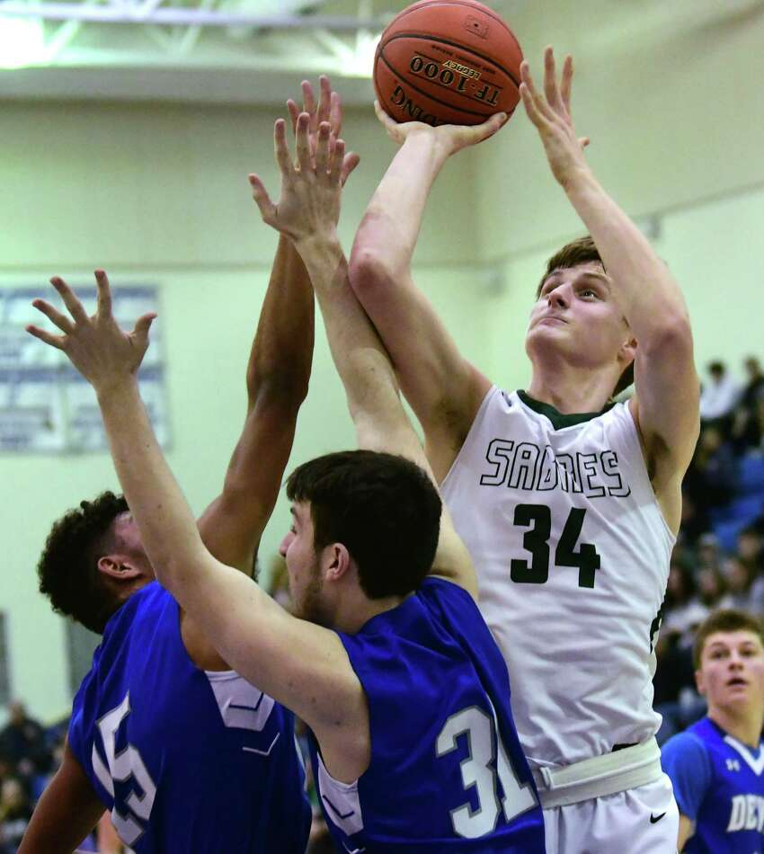 Schalmont's Shane O'Dell drives to the basket during the Class B boys' basketball regional against Ogdensburg Free Academy on Tuesday, March 10, 2020 in Saratoga Springs, N.Y. (Lori Van Buren/Times Union)