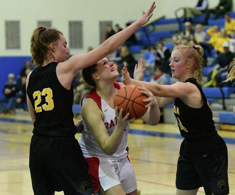 Mechanicville's Amy DeSiena drives to the basket against Canton's Emily Wentworth, left, and Esther Shipman during the Class B girls' basketball regional on Tuesday, March 10, 2020 in Saratoga Springs, N.Y. (Lori Van Buren/Times Union)