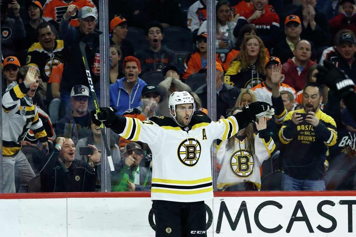 Boston Bruins' Patrice Bergeron celebrates after scoring a goal during the third period of an NHL hockey game against the Philadelphia Flyers, Tuesday, March 10, 2020, in Philadelphia. Boston won 2-0. (AP Photo/Matt Slocum)