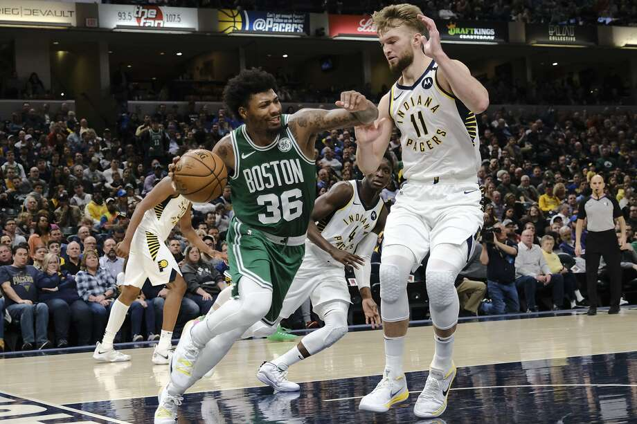 Boston Celtics guard Marcus Smart (36) drives around Indiana Pacers forward Domantas Sabonis (11) during the second half of an NBA basketball game in Indianapolis, Tuesday, March 10, 2020. The Celtics won 114-111. (AP Photo/AJ Mast) Photo: AJ MAST / Associated Press
