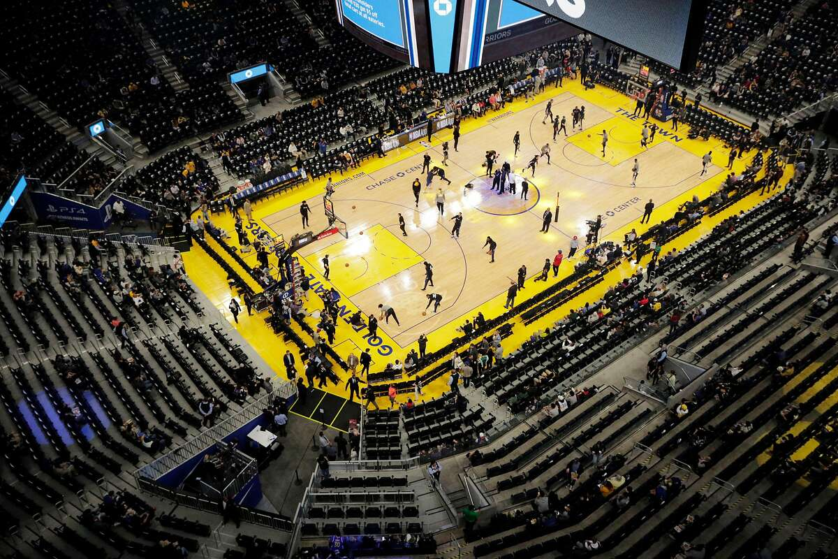 With minutes to go before tipoff, empty seats were evident in many sections of the arena as the Golden State Warriors warmed up before they played the Los Angeles Clippers at Chase Center in San Francisco, Calif., on Tuesday, March 10, 2020.