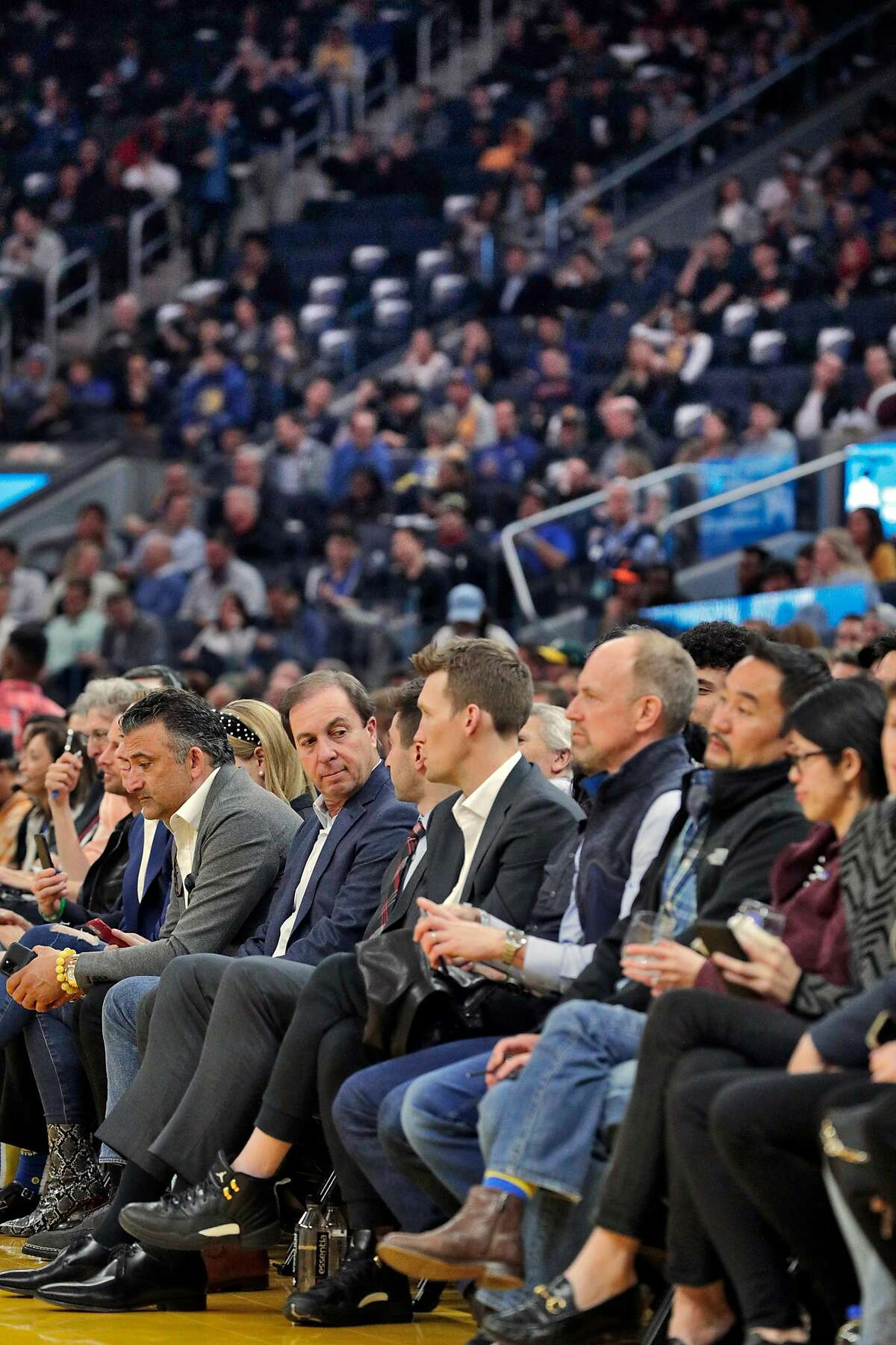 A large amount of empty seats are visible behind Warriors owner Joe Lacob in the first half as the Golden State Warriors played the Los Angeles Clippers at Chase Center in San Francisco, Calif., on Tuesday, March 10, 2020.