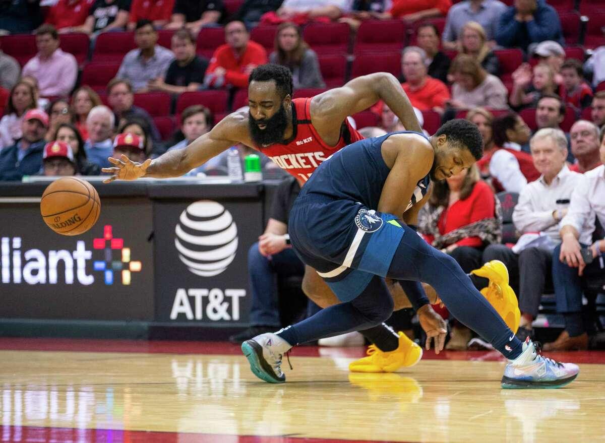 Rockets guard James Harden (runs into the Timberwolves' Malik Beasley during the second half Tuesday night.