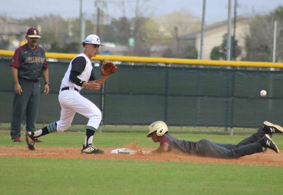 Summer Creek's Ayden Bell slides into third base, taking advantage of a two-base error in right field during second inning action Tuesday afternoon. Photo: Robert Avery