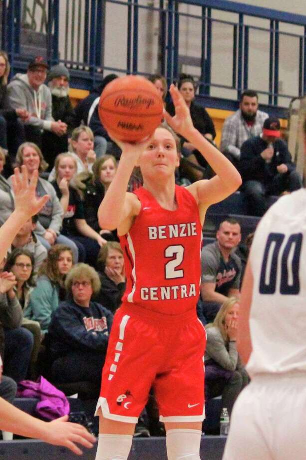 Ellen Bretzke takes advantage of an open perimeter look during the Huskies' loss to Big Rapids on March 4. (Photo/Robert Myers)