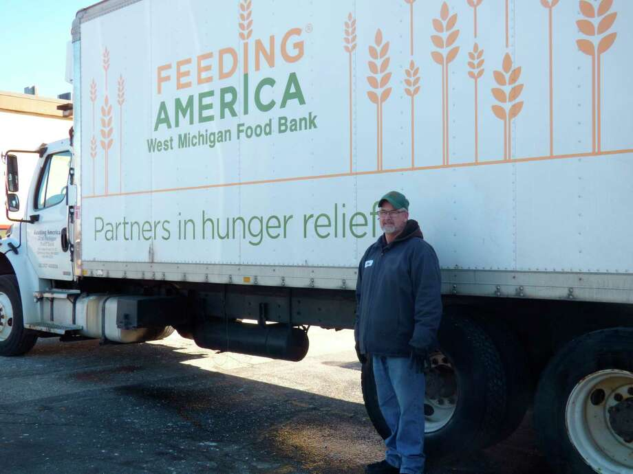 Feeding America driver Jerry Grooten delivers food to the Manistee Friendship Society food pantry on Tuesday. (Scott Fraley/News Advocate)