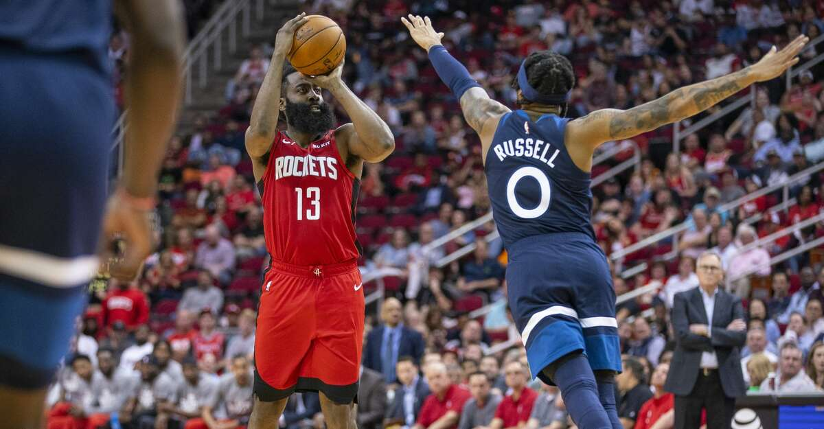 Houston Rockets guard James Harden (13) steps back to shoot our Minnesota Timberwolves guard D'Angelo Russell (0) during the second half of an NBA game, Tuesday, March 10, 2020, at Toyota Center in Houston.
