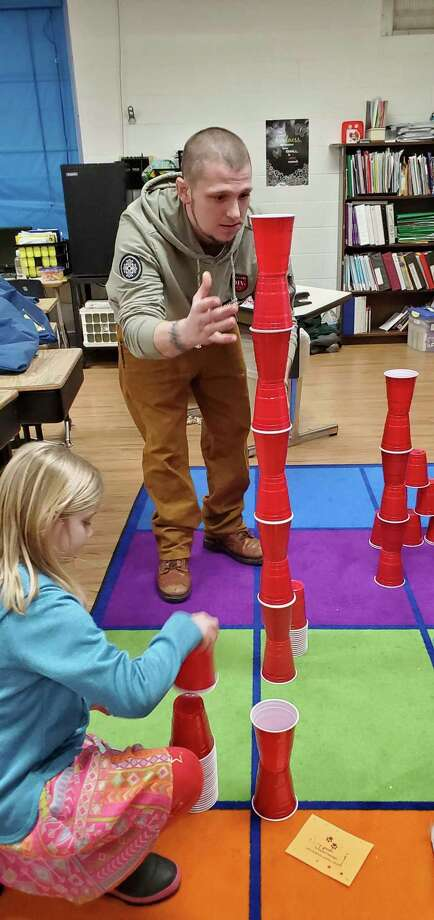 Building towers with cups made for a fun family activity. (Courtesy photo/Amiee Erfourth)