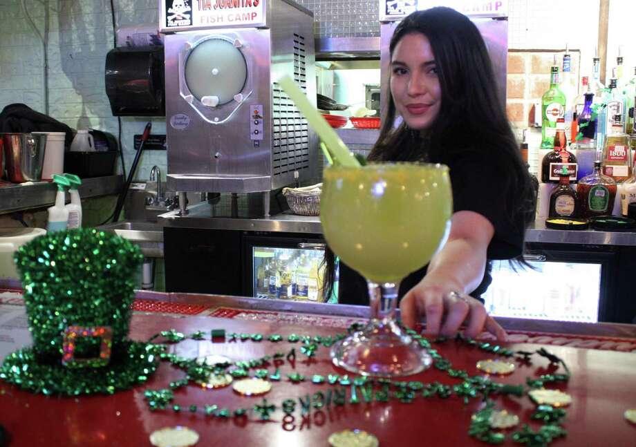 "Hazel Morton minds the barTia Juanitas in Beaumont. Her holiday offering is called ""Pot of Gold."" Photo: Sierra Kondos / Sierra Kondos/"