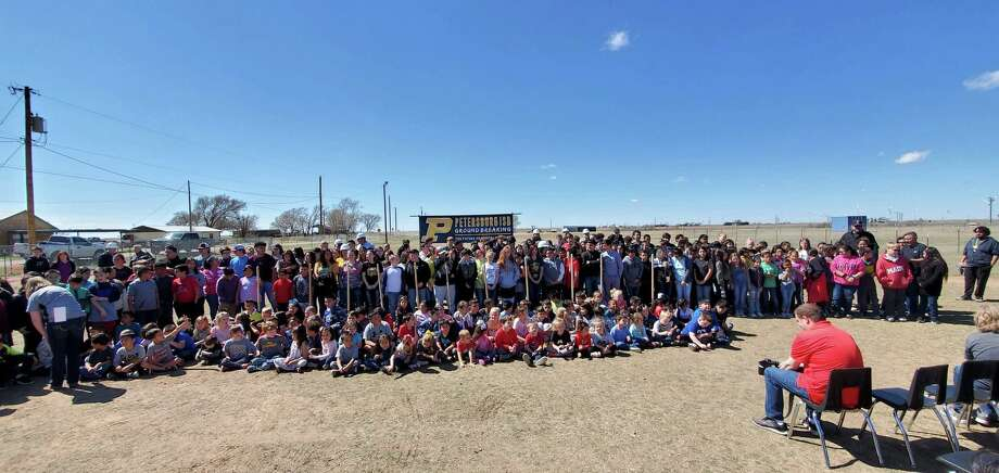 Petersburg students past and present celebrated the groundbreaking of the district's new campus with a special ceremony and cake on Monday afternoon. Photo: Courtesy Photo/Petersburg ISD