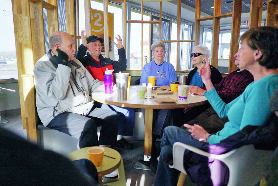 From left to right, Chuck Clark of Gansevoort, George Bourdeau of South Glens Falls, Pete Sweet of South Glens Falls, Fran Many of South Glens Falls, John Schaffer of Moreau and Nancy Nicholson of Queensbury talk about what they felt at their homes during the earthquake as they met for their morning coffee on Wednesday, March 11, 2020, in South Glens Falls, N.Y. A minor earthquake measuring 3.1-magnitude on the Richter scale shook the area Wednesday morning. (Paul Buckowski/Times Union)