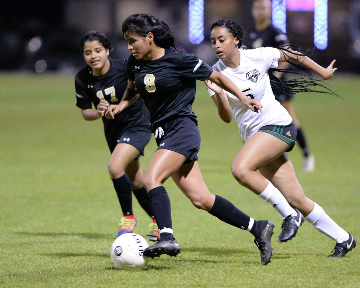 Sydney Ponce (9) of Spring Woods is chased by Leslie Amador (5) of CyFair during the first half of a girls 6A-III District 17 soccer game between the Spring Woods Tigers and the Cy Falls Eagles on Monday, March 10, 2020 at Spring Woods High School, Houston, TX.