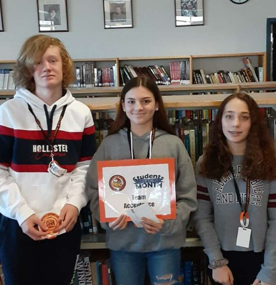Shelton Intermediate School students Caden Mitchell, Ella Welsh and Lauren Dreyer, part of Team Acceptance, were among the school's honored students in December. Photo: Contributed Photo / / Connecticut Post
