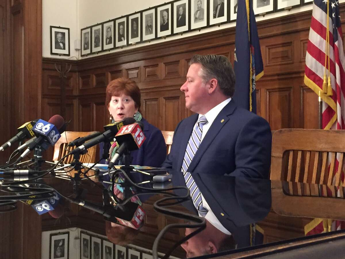 Mayor Kathy Sheehan, left, and Albany County Executive Dan McCoy discuss the decision to go ahead with Saturday's St. Patrick's Day parade in Albany despite worries about the coronavirus.