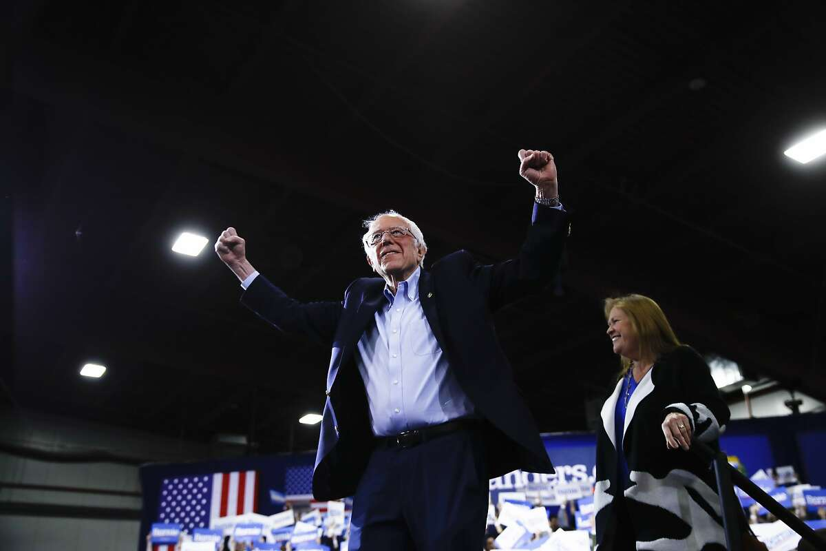 Democratic presidential candidate Sen. Bernie Sanders, I-Vt., accompanied by his wife Jane O'Meara Sanders, arrives to speak during a primary night election rally in Essex Junction, Vt., Tuesday, March 3, 2020. (AP Photo/Matt Rourke)