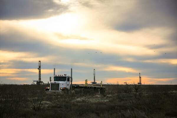 Three drilling rigs operate near Orla, Texas, in the Permian Basin, February 17, 2020. MANDATORY CREDIT: The Oilfield Photographer, Inc.