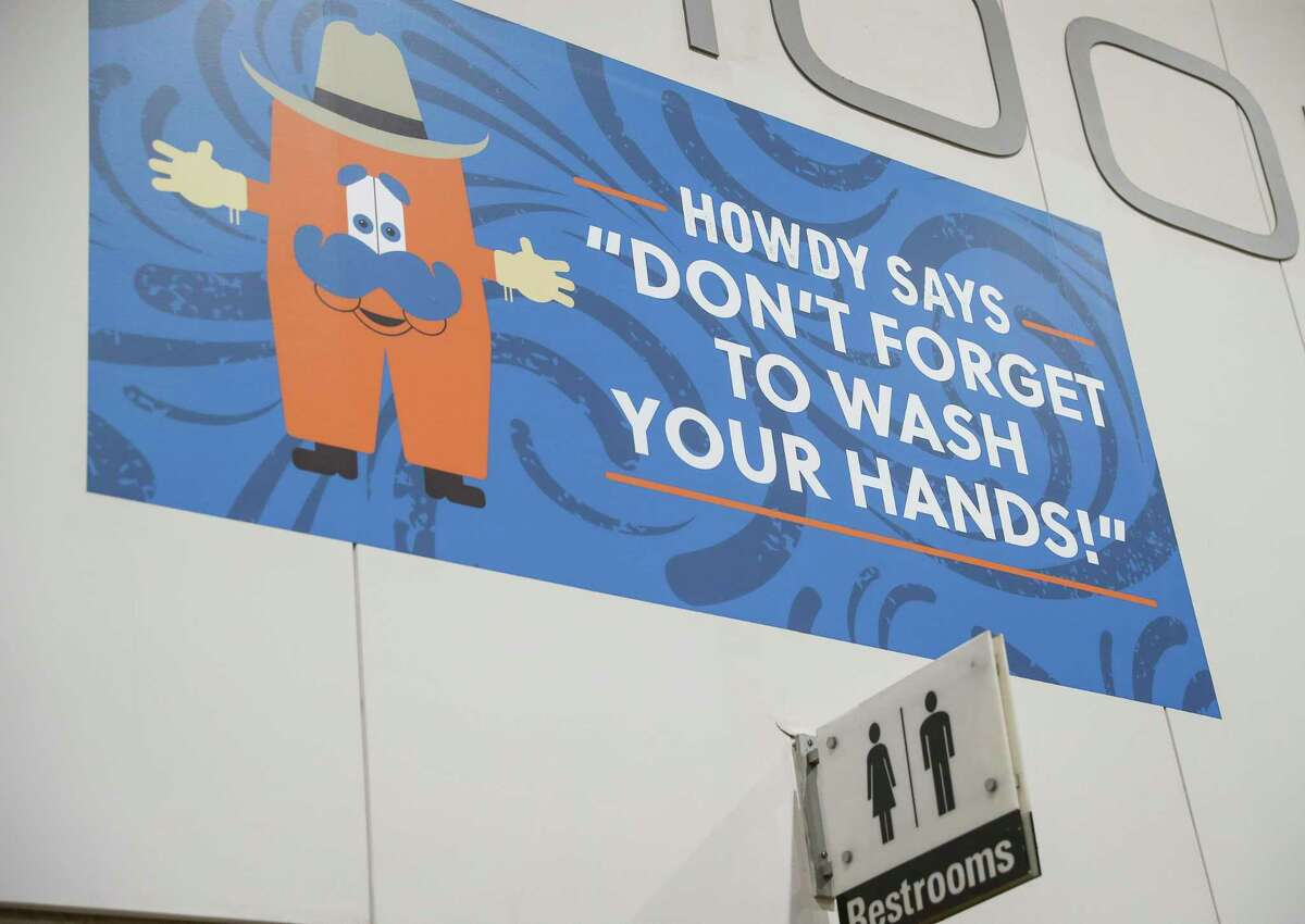 A sign tells people to wash their hands at the Houston Livestock Show and Rodeo on Friday, March 6, 2020, at NRG Center in Houston.