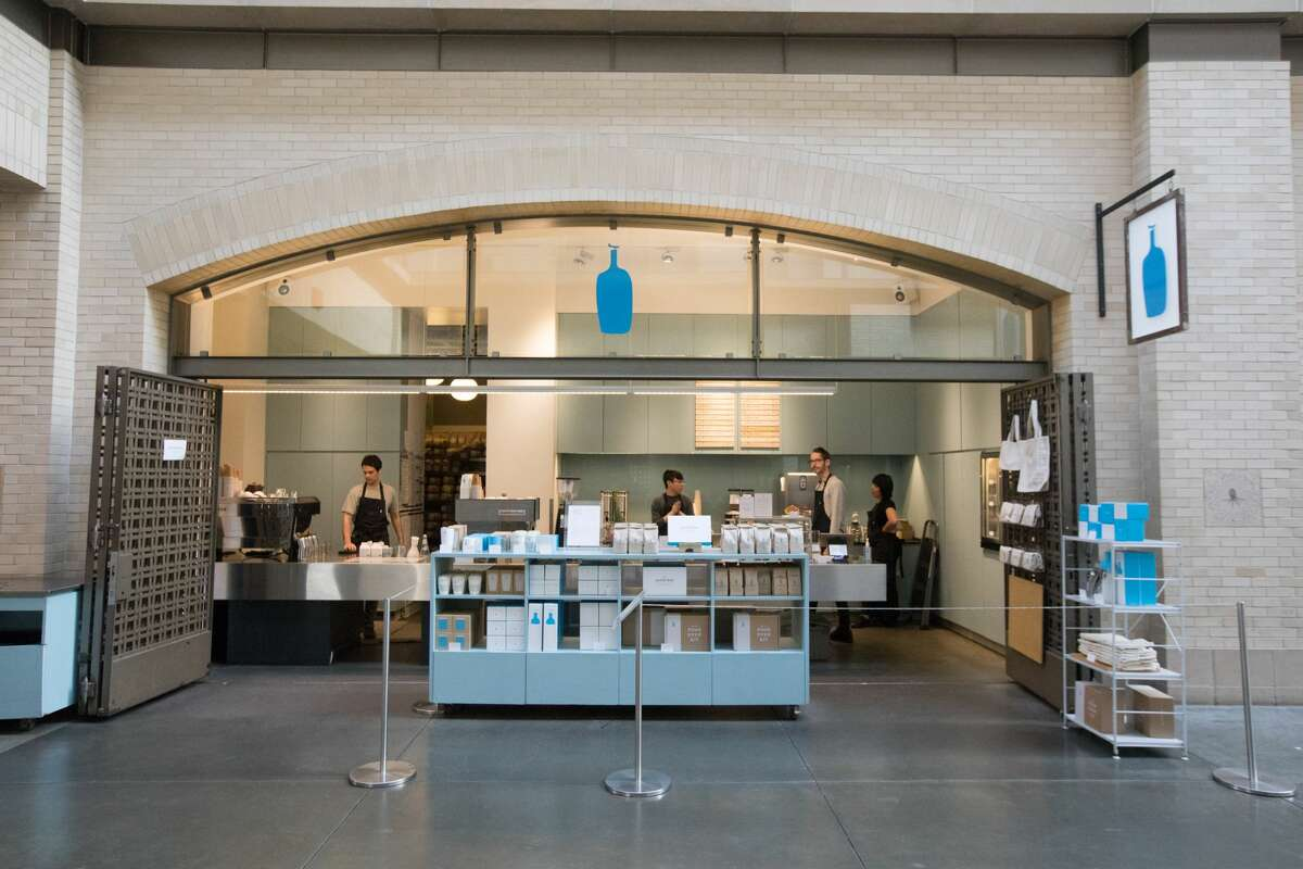 Employees at the Blue Bottle at the Ferry Building waited for customers in San Francisco, Calif. on March 10, 2020. Because of coronavirus concerns, the streets in San Francisco were unusually quiet. Many employers encouraged workers to stay at home.