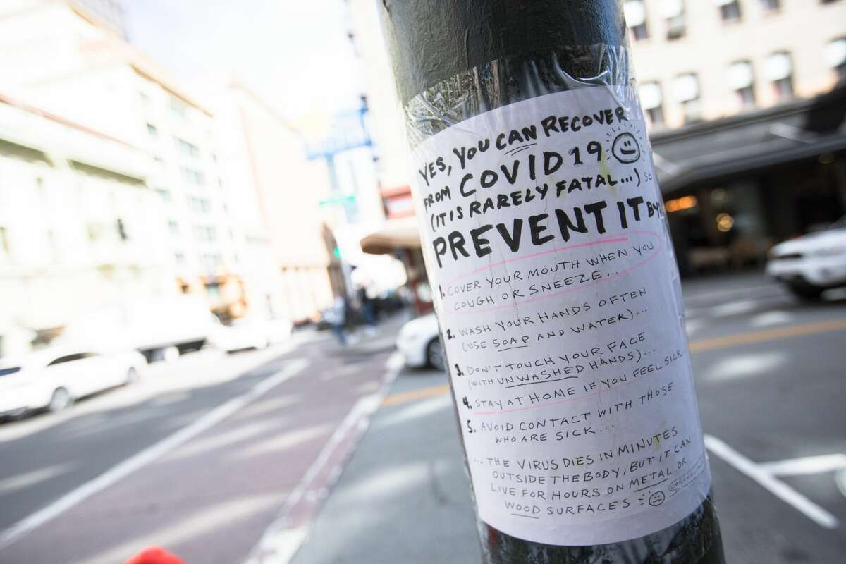 A handmade sign on Grant Ave. in San Francisco, Calif. on March 10, 2020 explains how to contain the COVID-19 coronavirus. The streets of San Francisco were noticeably more quiet because of the coronavirus, which has prompted many employees to encourage workers to stay at home.