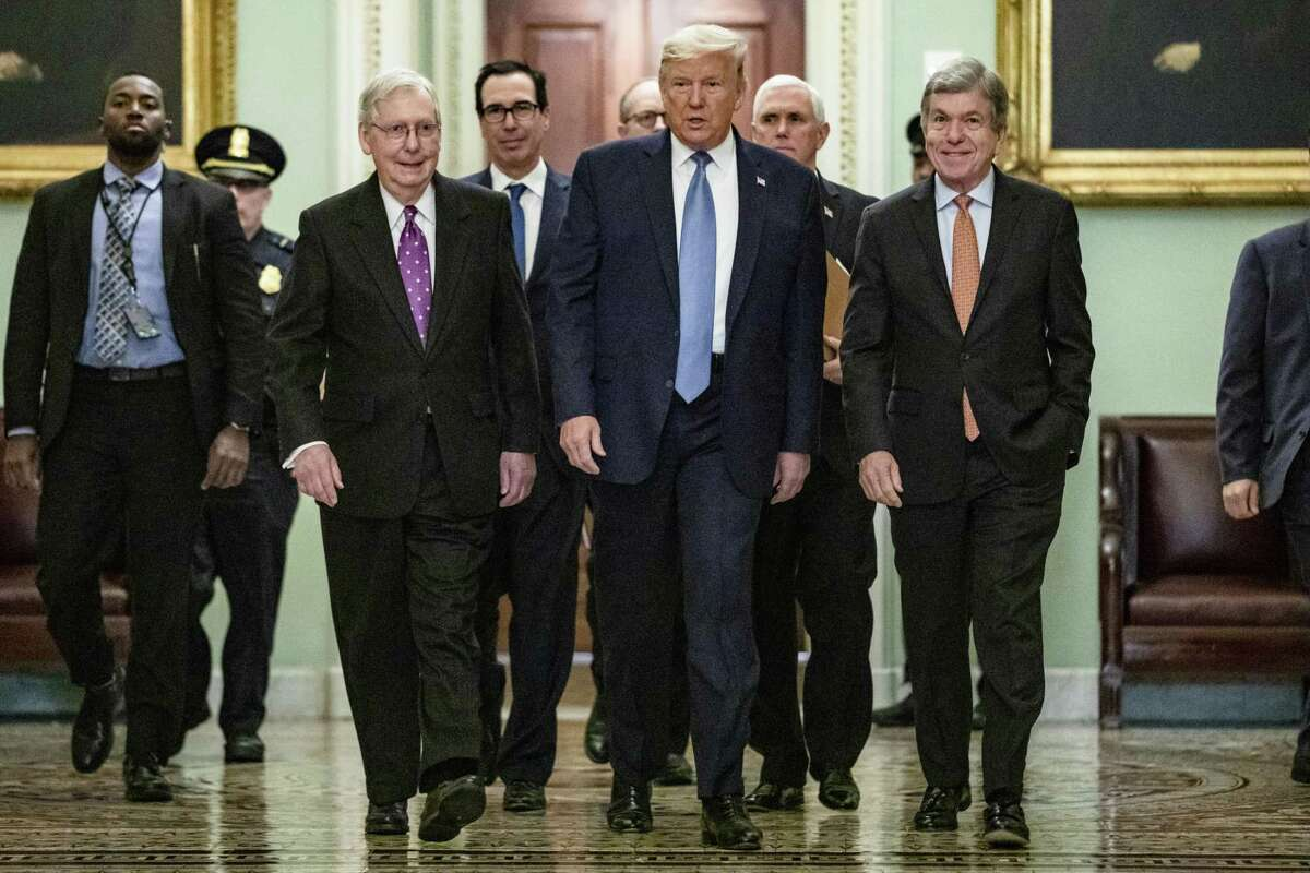 U.S. President Donald Trump arrives at the US Capitol to attend the Republicans weekly policy luncheon on March 10, 2020 in Washington, DC. He is flanked by (L-R) Senate Majority Leader Mitch McConnell (R-KY), Treasury Secretary Steve Mnuchin, Vice President Mike Pence and Republican Policy Committee Chairman Senator Roy Blunt (R-MO).