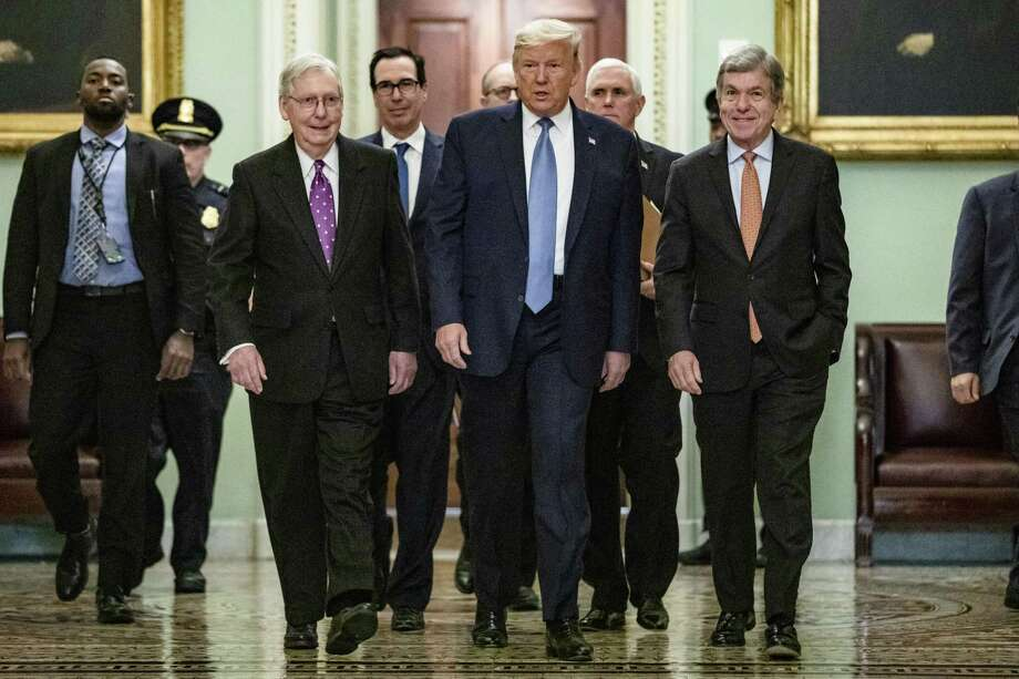 U.S. President Donald Trump arrives at the US Capitol to attend the Republicans weekly policy luncheon on March 10, 2020 in Washington, DC. He is flanked by (L-R) Senate Majority Leader Mitch McConnell (R-KY), Treasury Secretary Steve Mnuchin, Vice President Mike Pence and Republican Policy Committee Chairman Senator Roy Blunt (R-MO). Photo: Samuel Corum / Getty / 2020 Getty Images