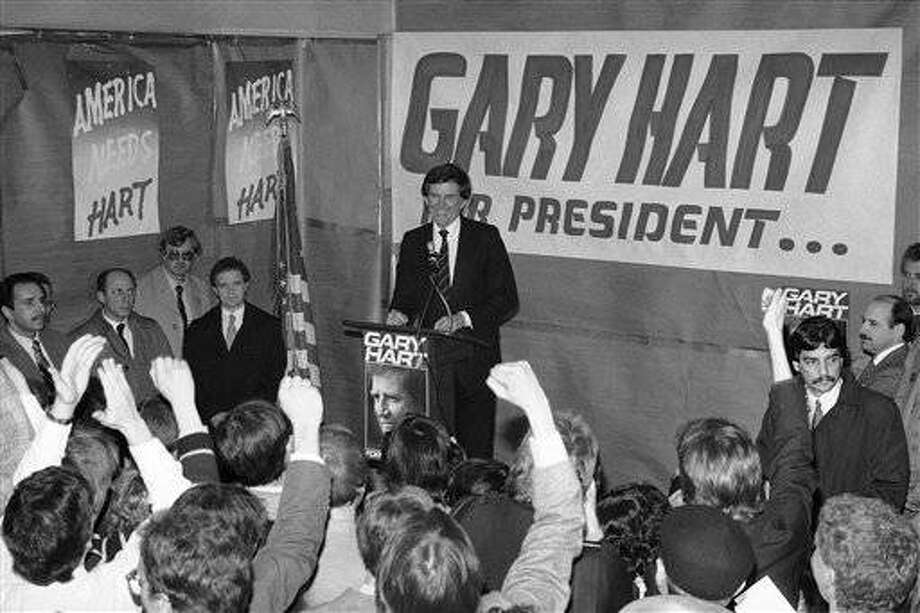 Democratic presidential hopeful Gary Hart reacts to the cheering crowd at the opening last week of his new campaign headquarters in downtown Chicago on March 11, 1984. Harts political hat trick in New England sparked support for his primary Campaign in Illinois, the site of the first Midwestern state primary on March 20. (AP Photo)