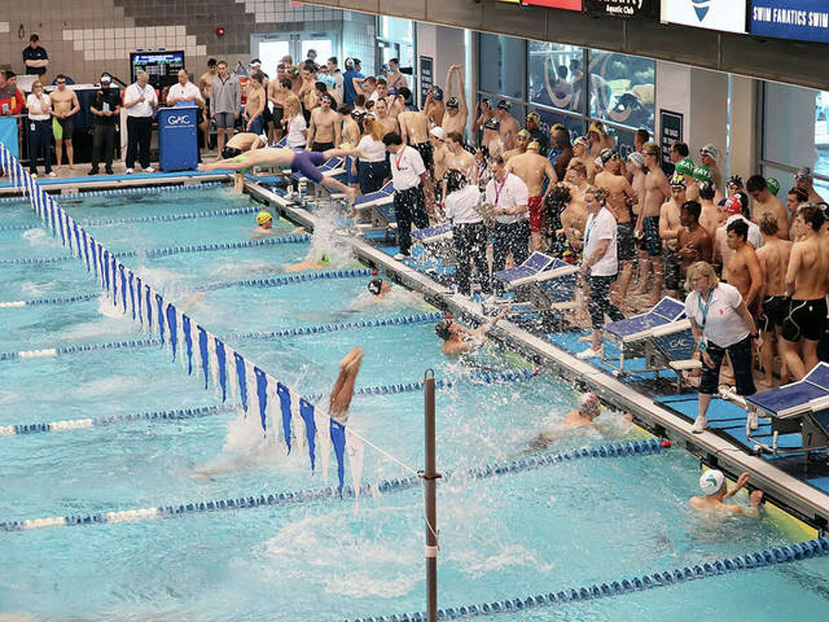 Swimmers hit the water during last year's YMCA Short Course Nationals at the Greensboro Aquatic Center in Greensboro, N.C. Tuesday, YMCA of the USA canceled the nationals, as well as all other in-person events through April 30 because of the spread of the Corona Virus.