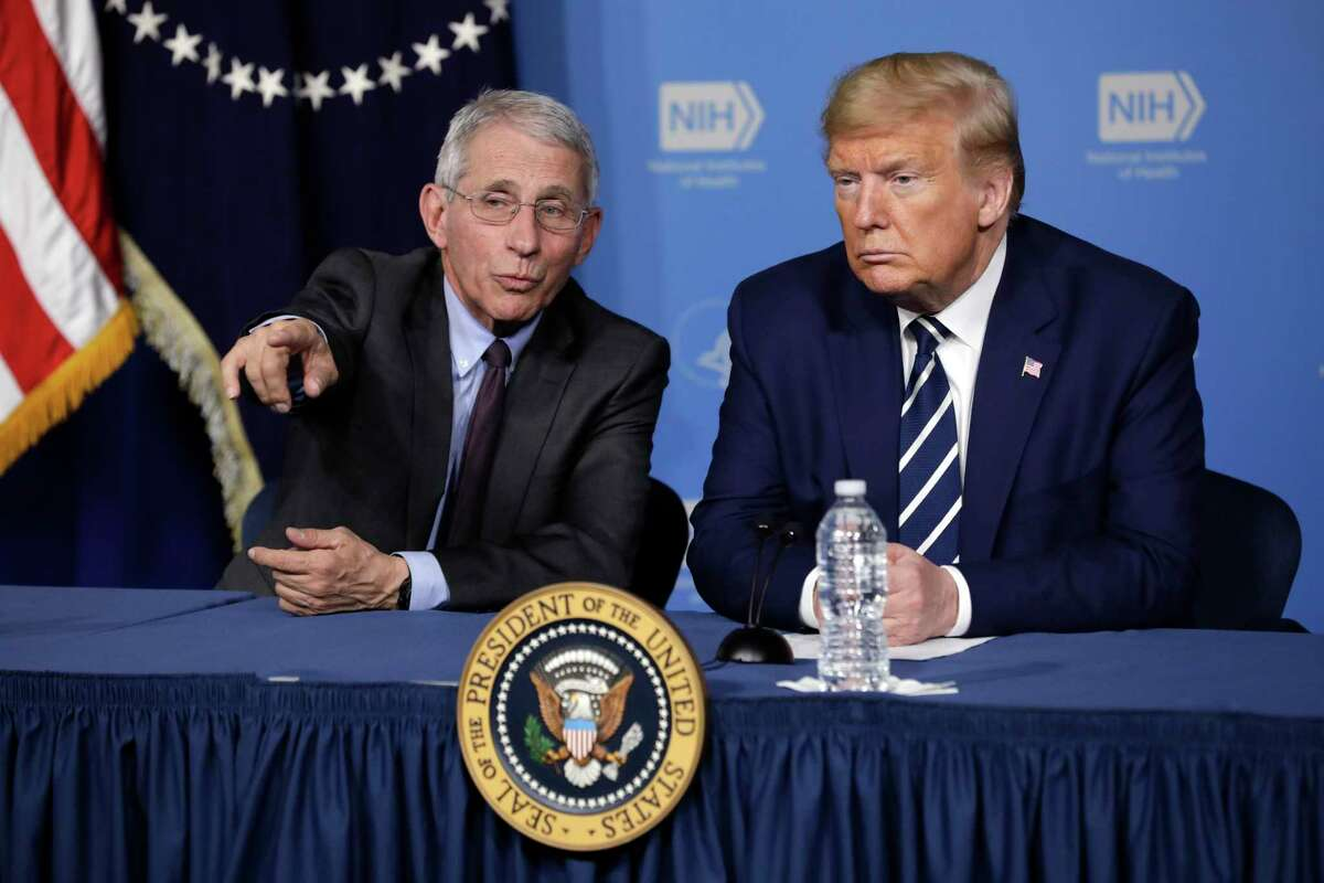 U.S. President Donald Trump, right, watches a video presentation next to Anthony Fauci, director of the National Institute of Allergy and Infectious Diseases, during a coronavirus roundtable last week. A reader questions Trump's decision to put Vice President Mike Pence in charge of the coronavirus response rather than Fauci.