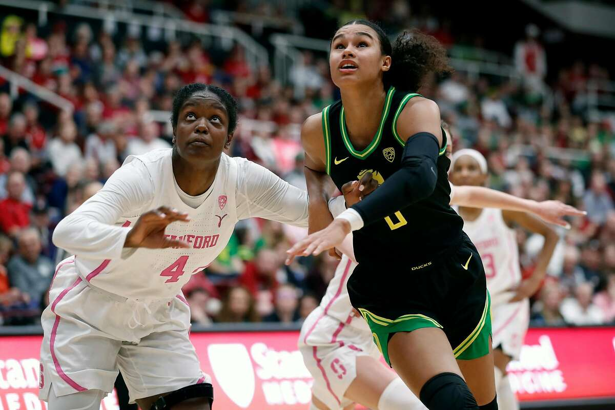 """Stanford's Nadia Fingal and Oregon""""s Satou Sabally vie for rebound position during Pac 12 women's basketball game at Maples Pavilion in Stanford, Calif., on Monday, February 24, 2020."""
