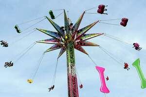 Fair-goers enjoy the midway offerings at the YMBL South Texas State Fair Saturday. Photo taken Saturday, March 23, 2019 Kim Brent/The Enterprise