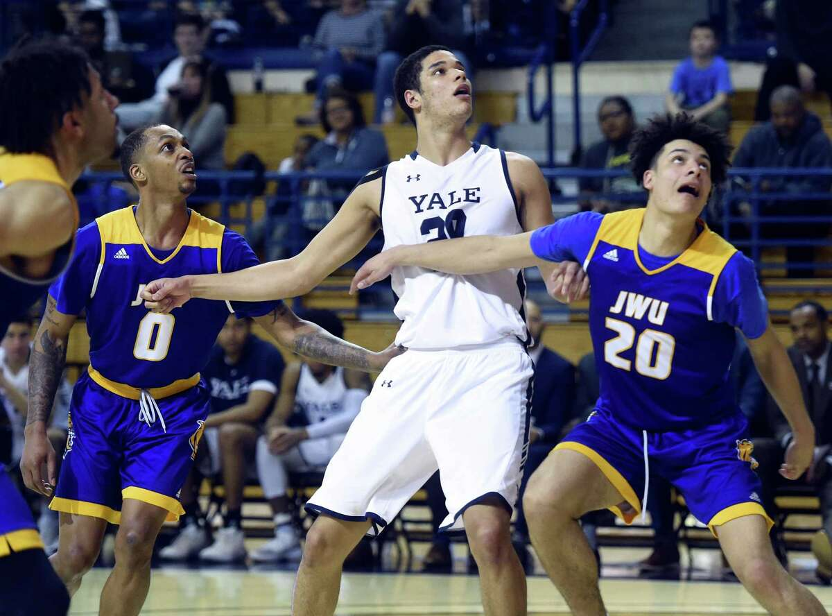 Yale's Paul Atkinson, center, announced that he wil transfer and play for Notre Dame next season.