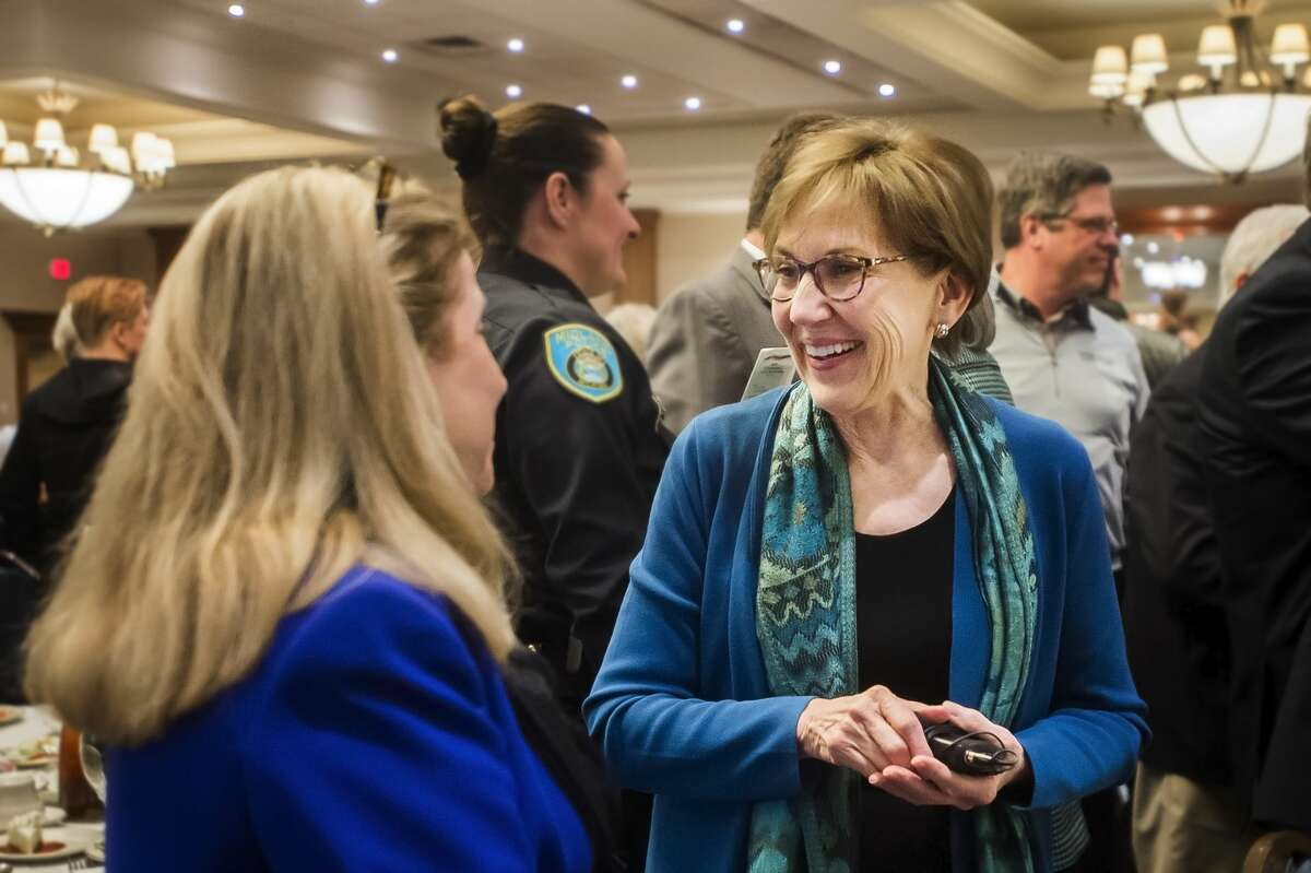 Mayor Maureen Donker chats with friends and colleagues after delivering the annual State of the City address Wednesday, March 11, 2020 at Great Hall Banquet & Convention Center. (Katy Kildee/kkildee@mdn.net)