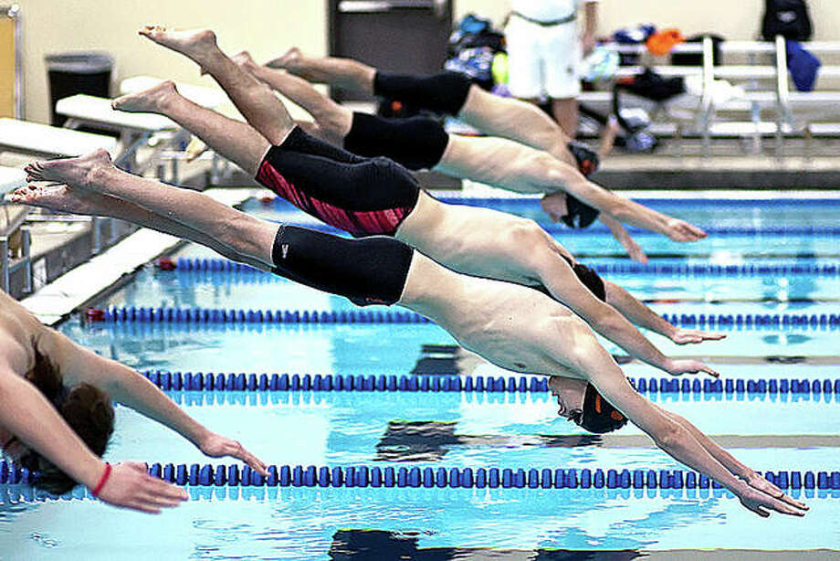 The YMCA National Swim meet has been canceled because of concern over the coronavirus, but the Heartland Area (state) meet, set for March 20-22 at the Chuck Fruit Aquatic Center in Edwardsville is on as scheduled, at least for now. Above, swimmers start in an earlier meet at the CFAC. Photo: Pete Hayes File | The Telegraph
