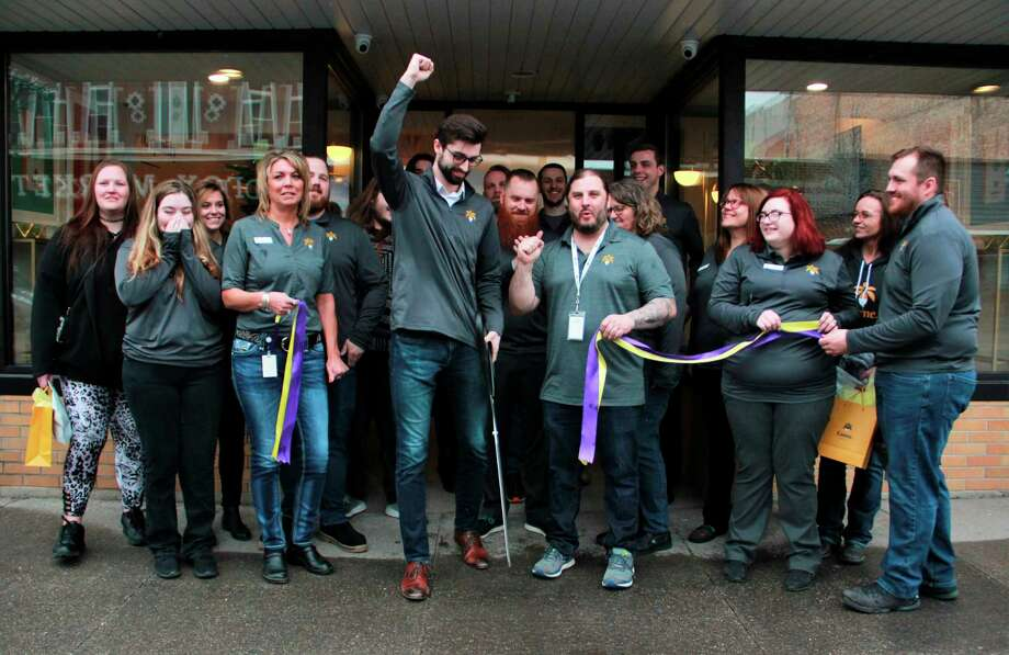 Lume employees, as well as a few customers, were all smiles Wednesday morning as Lume Cannabis Co. inventory analyst Tyler Johnson cut a ribbon in celebration of opening day. (Pioneer photo/Alicia Jaimes)