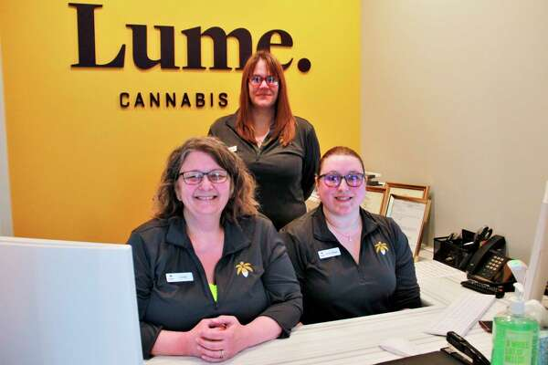 LuminariesCindy Horn, Amber Moon and Emily Maye Moore sit atpatient intake, excited for their first customer. Luminaries are responsible for creating a unique experience for the customer, while answer any questions the customer may have in a one-on-one, discreet manner, saidJohn Gregory, Chief Marketing Officer of Lume Cannabis Company.(Pioneer photo/Alicia Jaimes)