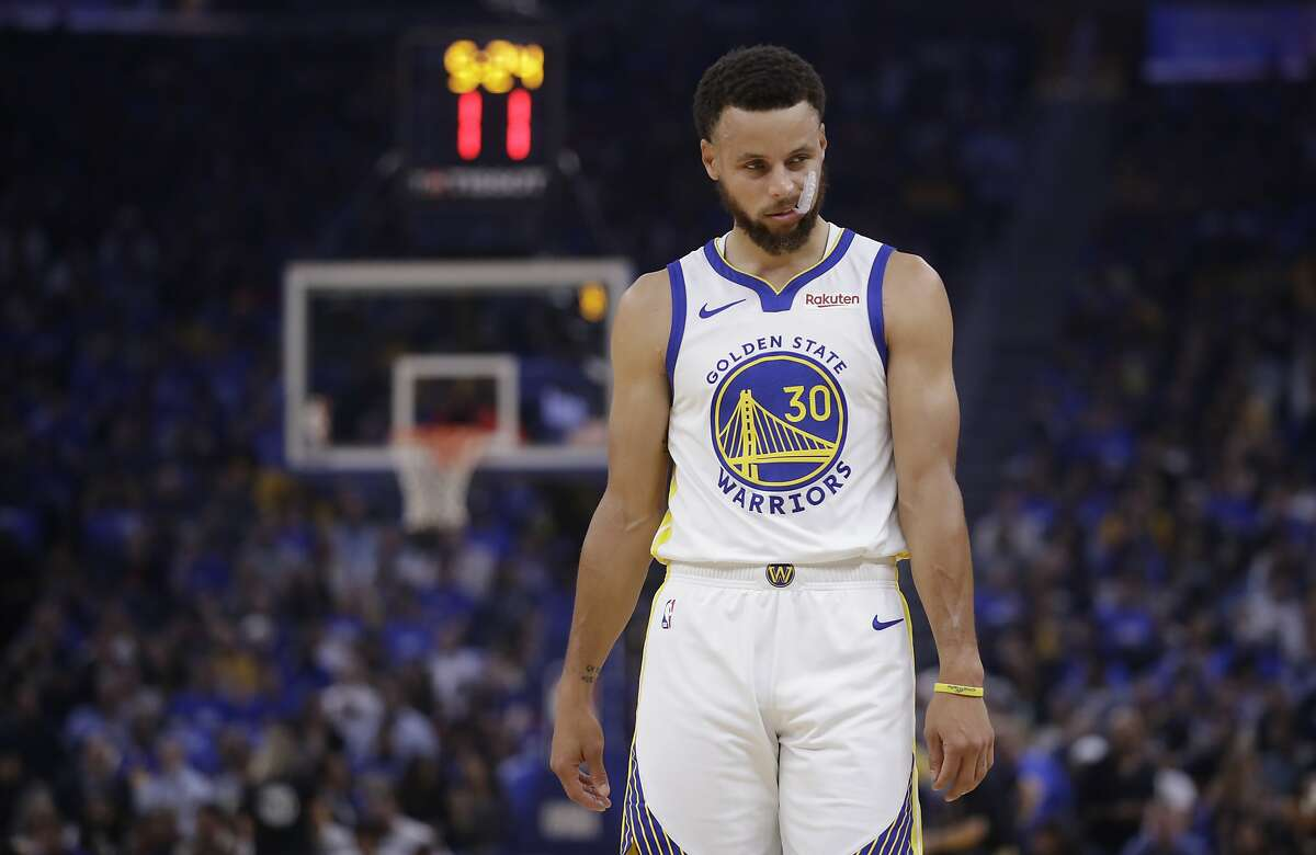 FILE - In this Oct. 24, 2019, file photo, Golden State Warriors' Stephen Curry walks on the court during the first half of an NBA basketball game against the Los Angeles Clippers in San Francisco.
